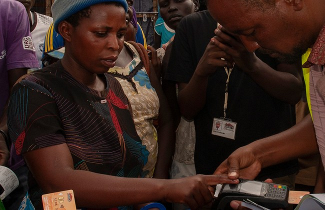 The distribution of cash-based assistance is verified using biometric data.